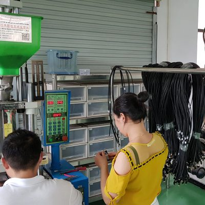Over molding process to manufacture connectors on cables